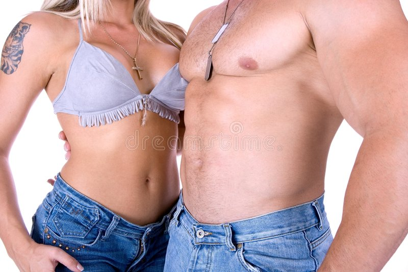 Par som poserar i jeans royaltyfri bild