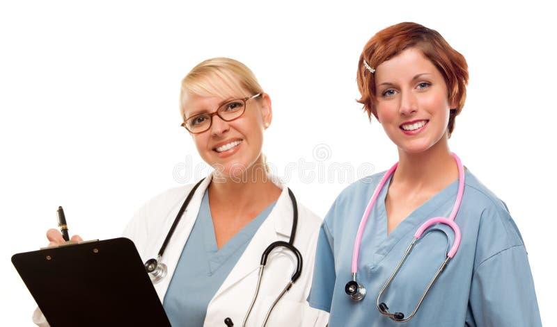 Para lekarki lub pielęgniarki na Białym tle obrazy stock