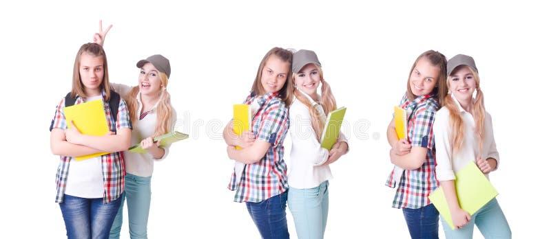 Para młodzi ucznie na bielu obraz stock