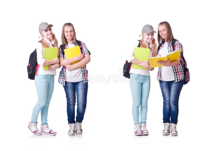 Para m?odzi ucznie na bielu zdjęcie stock