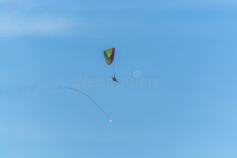 Para motor glider flying and fire work stock photography