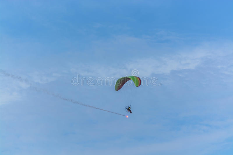 Para motor glider flying and fire work royalty free stock photography