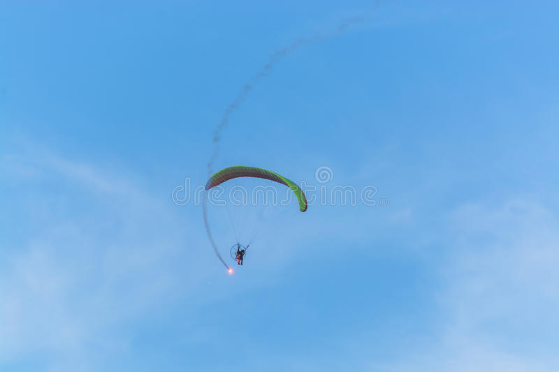 Para motor glider flying and fire work royalty free stock image