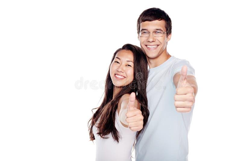 Para pokazuje kciuk up podpisuje zdjęcia stock