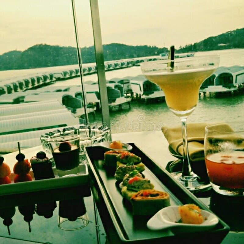 Para puesta del sol que espera en el puerto Dickson Resort fotos de archivo