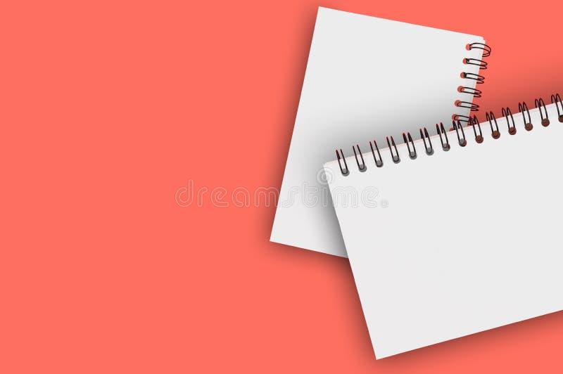 Para pustego papieru notepads z spirala drutem dla notatki lub rysunkiem na tle żywy koralowy kolor zanieczyszczenie na rzecznym  obrazy royalty free
