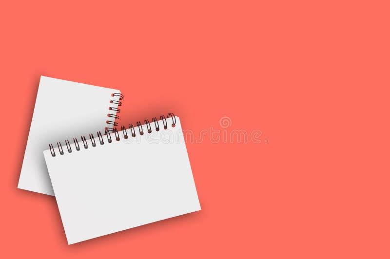 Para pustego papieru notepads z spirala drutem dla notatki lub rysunkiem na tle żywy koralowy kolor zanieczyszczenie na rzecznym  zdjęcia royalty free
