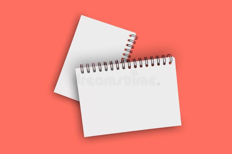 Para pustego papieru notepads z spirala drutem dla notatki lub rysunkiem w centrum na tle żywy koralowy kolor Odbitkowa przestrze zdjęcia royalty free