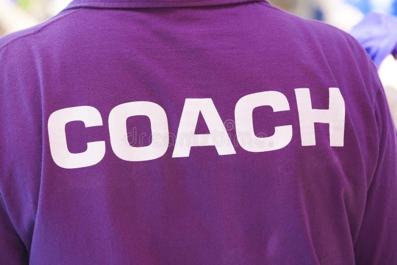 Para trás da camisa de um treinador fotografia de stock