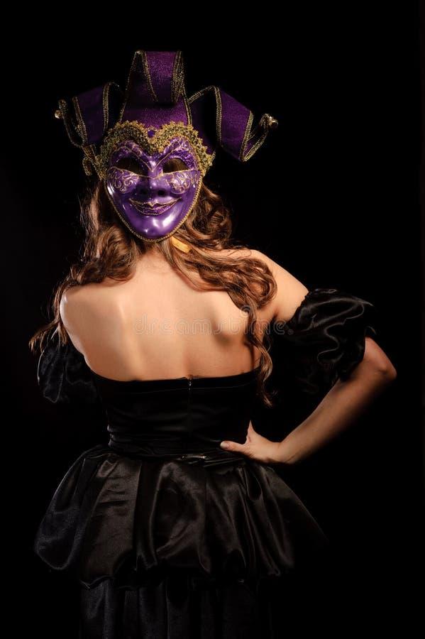 Para trás da menina bonita com máscara fotos de stock royalty free