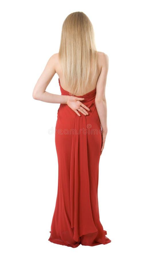 Para trás da menina magro em um vestido de noite imagens de stock royalty free