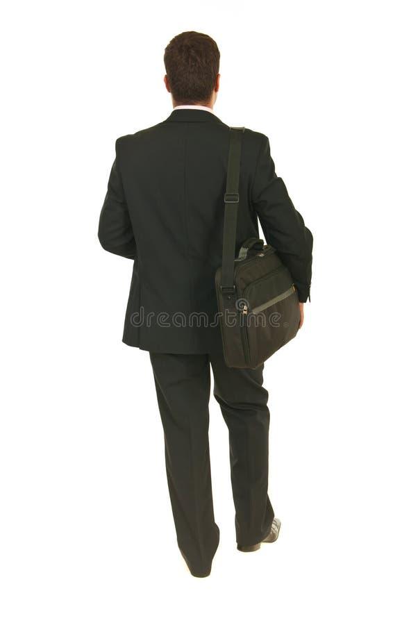 Para trás do homem de negócio que vai trabalhar imagens de stock