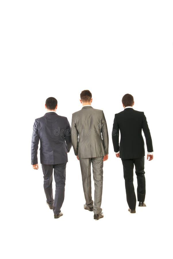 Para trás do passeio dos homens de negócio fotografia de stock