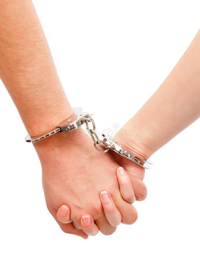 para zakłada kajdanki ręki łączącego s zdjęcia royalty free