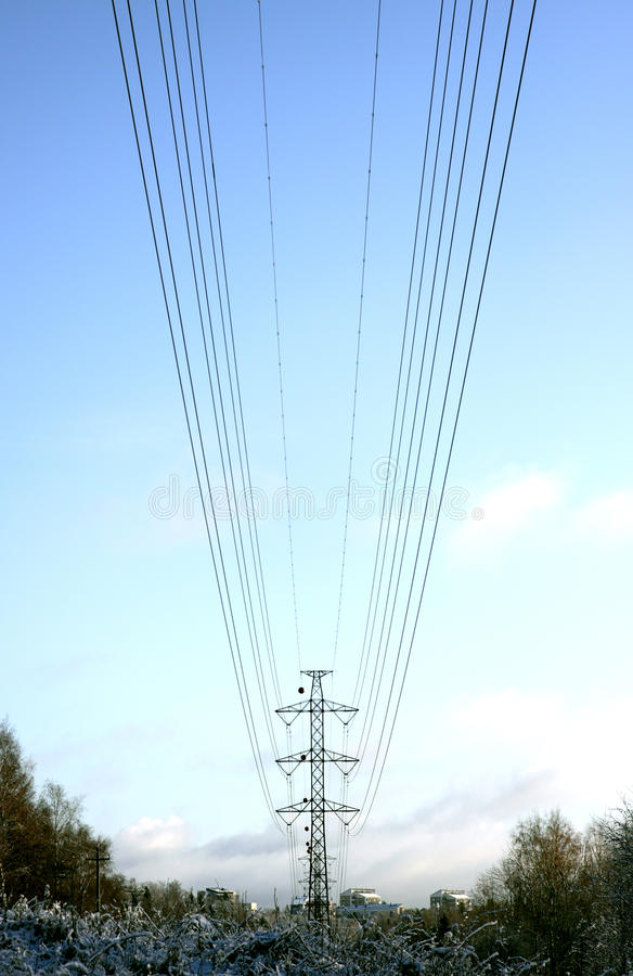 The parabolas. The conductors of a high-voltage transmission line hanging in the form of parabolas royalty free stock photography
