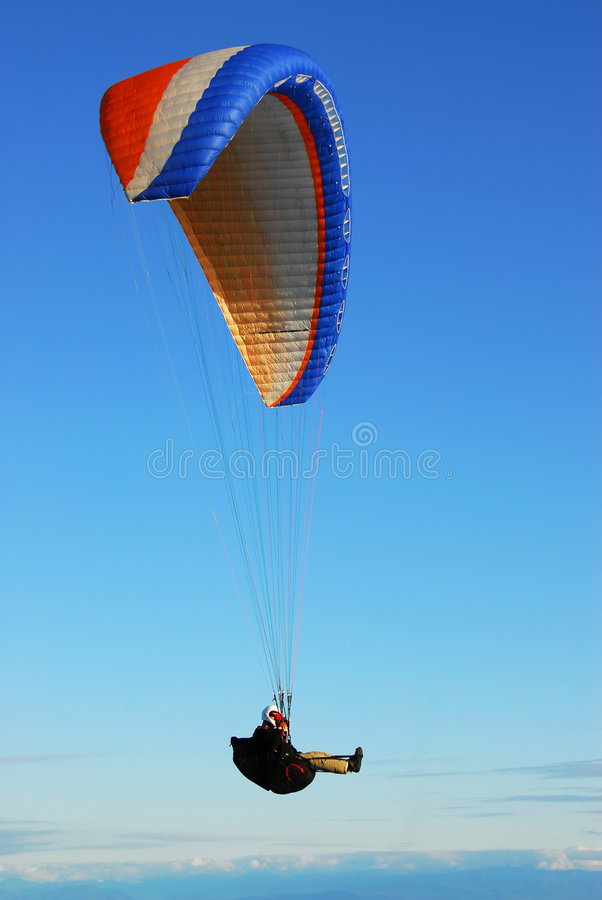 Parachute flying in sky stock photography