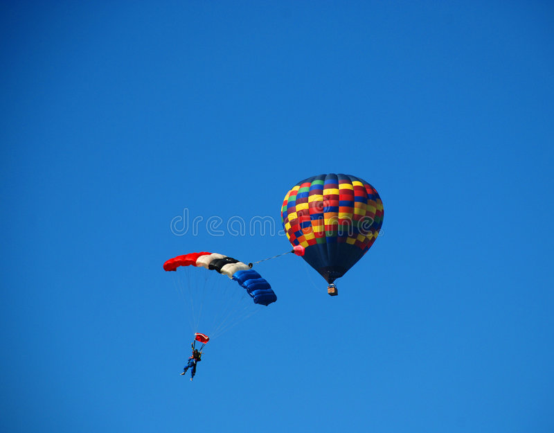Parachute with Hot Air Balloon royalty free stock photos