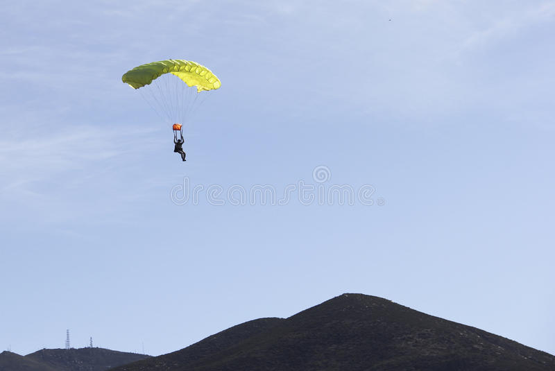 Parachute jumper returns to earth royalty free stock photo