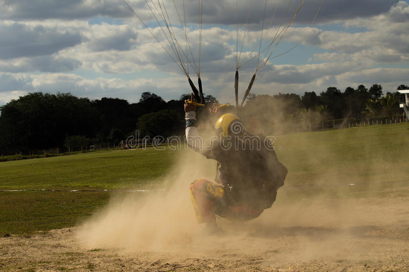 Parachute landing in the sand. stock photo
