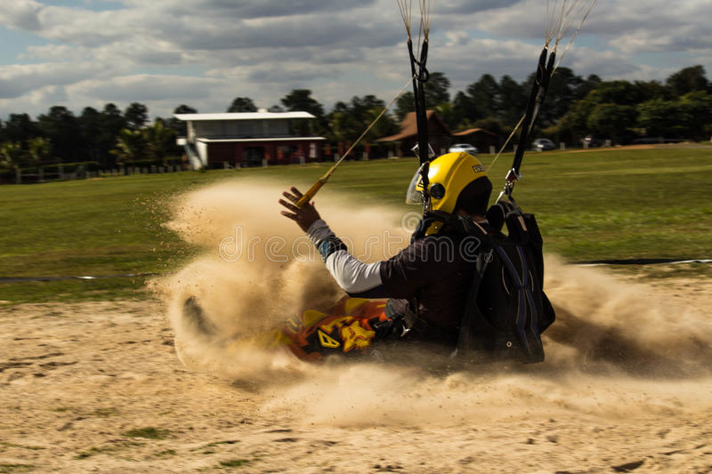 Parachute landing in the sand. stock images
