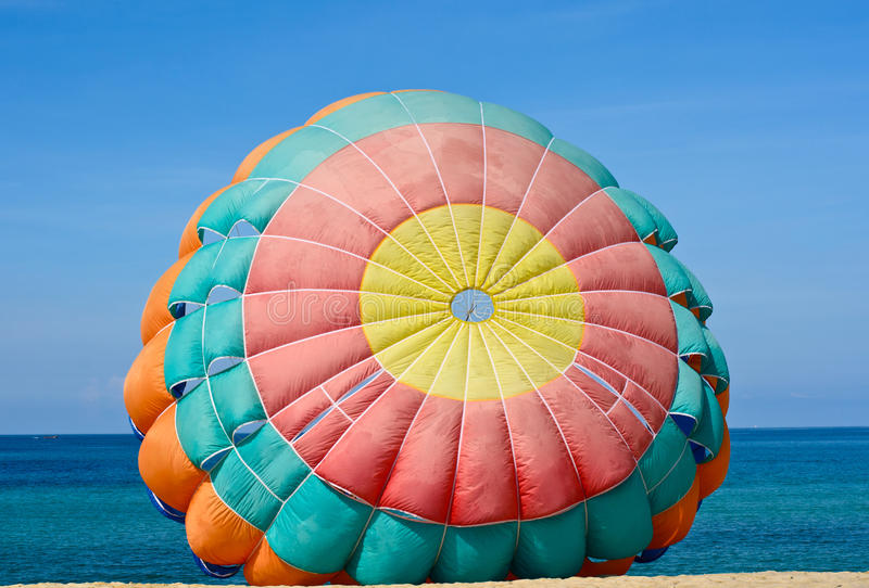 Parachute for parasailingon the beach in blue sky. Closeup parachute for parasailingon the beach in blue sky royalty free stock photography