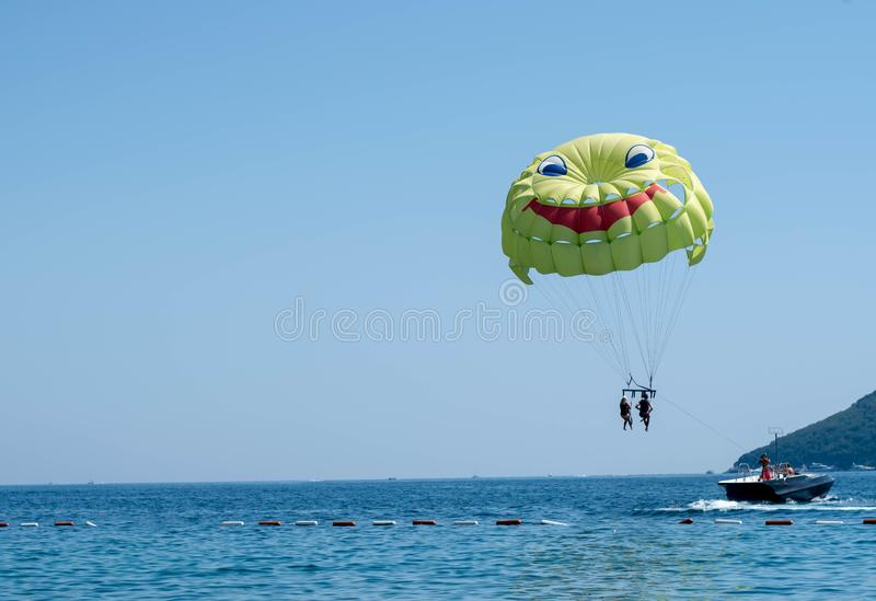 Parachute tied to a high-speed boat at sea royalty free stock photo