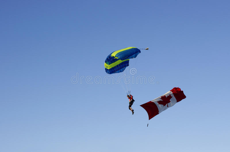 Parachuter with Canadian flag royalty free stock photography