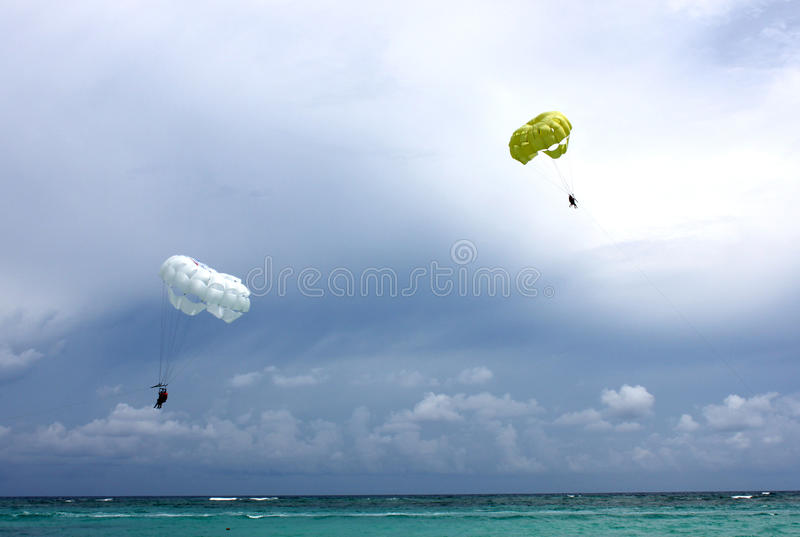 Parachutes over the ocean royalty free stock images