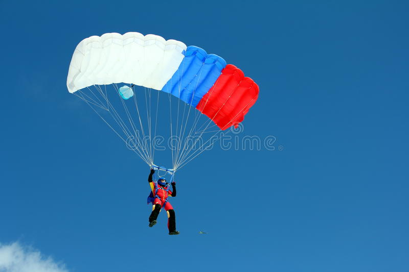 Parachuting. Freefall in blue sky royalty free stock images