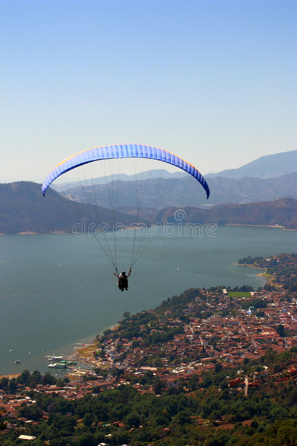 Parachuting. Over the lake of valle de bravo, in mexico royalty free stock photography