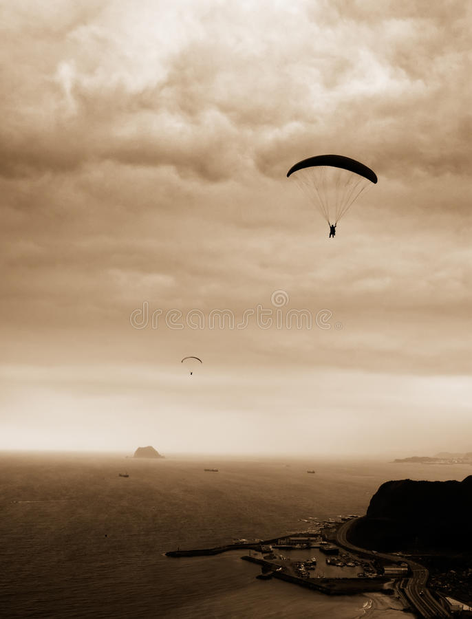 Parachuting. It is a kind of sport called parachuting over the sea royalty free stock photos