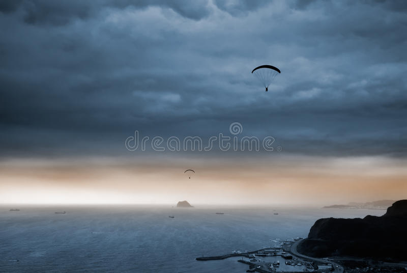 Parachuting. It is a kind of sport called parachuting over the sea royalty free stock image