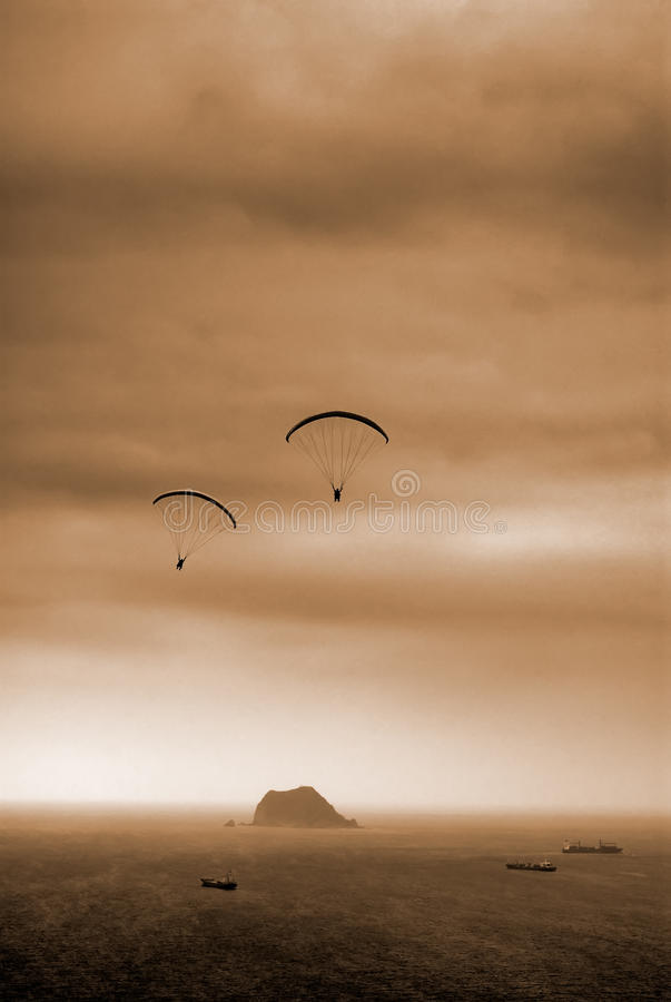 Parachuting. It is a kind of sport called parachuting over the sea royalty free stock photography