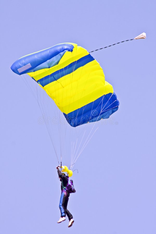 Parachuting against a blue sky. In Portugal royalty free stock photo