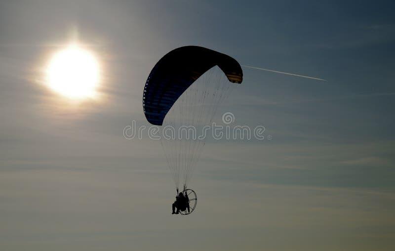 Parachuting. Black silhouette of man parachuting stock photography