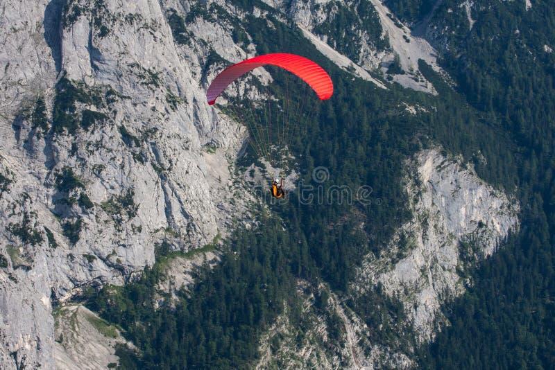 Parachuting. Extreme parachuting in high mountains Alps Austria royalty free stock photos