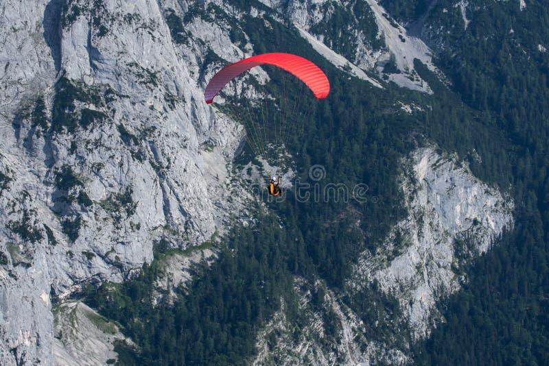 Parachuting. Extreme parachuting in high mountains Alps Austria stock photos