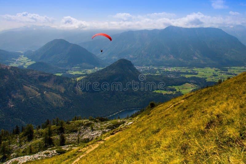 Parachuting. Extreme parachuting in high mountains Alps Austria stock photo
