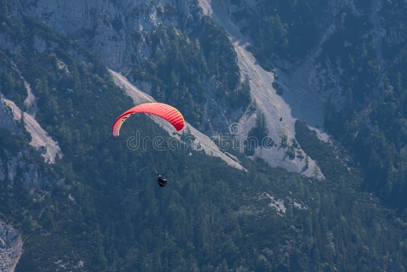 Parachuting. Extreme parachuting in high mountains Alps Austria stock image