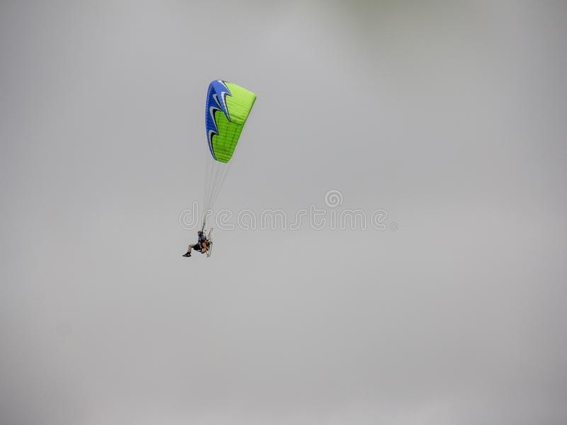 Parachuting in a foggy sky. Fly in the sky using a parachute royalty free stock photos
