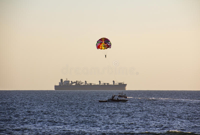 Parachuting in Goa. Parachuting is a trendy holiday activity in Goa royalty free stock images