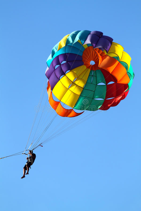 Parachuting over a sea. Stock image of parachuting over a sea, towing by a boat royalty free stock images