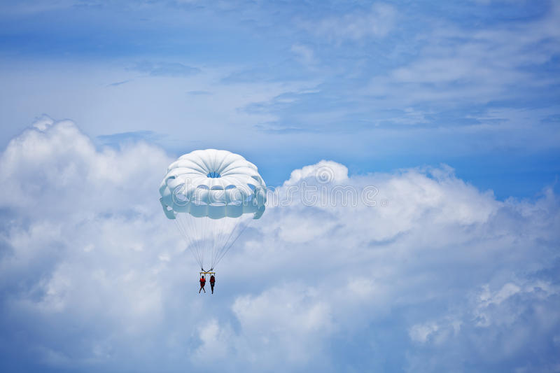 Parachuting in the sky. Parachuting in the blue caribbean sky royalty free stock images
