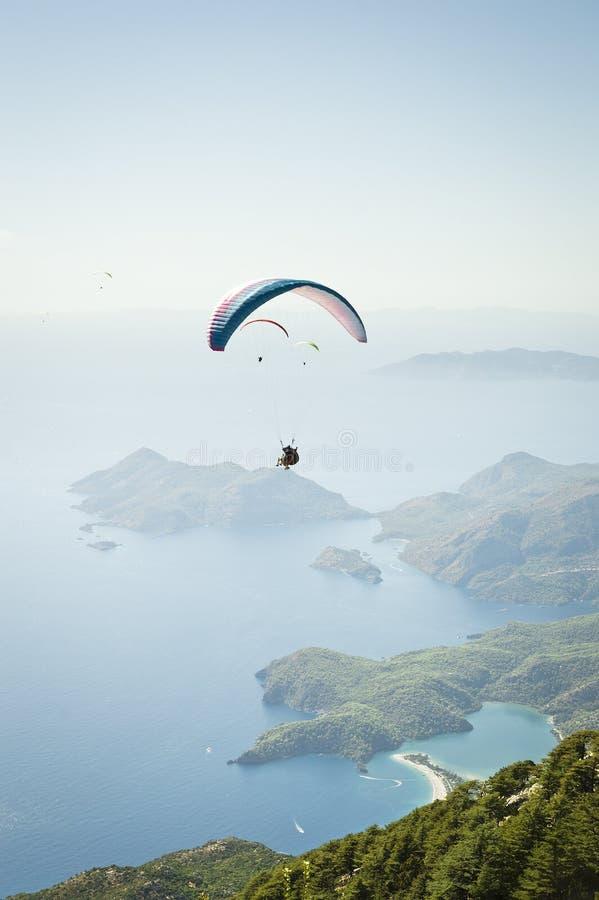 Parachuting. Vibrant color, vertical image stock image