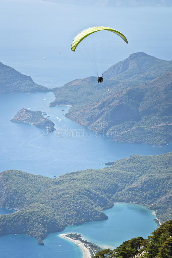 Parachuting. Vibrant color, vertical image royalty free stock image