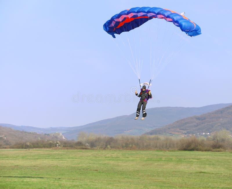 Parachutist landing royalty free stock photos