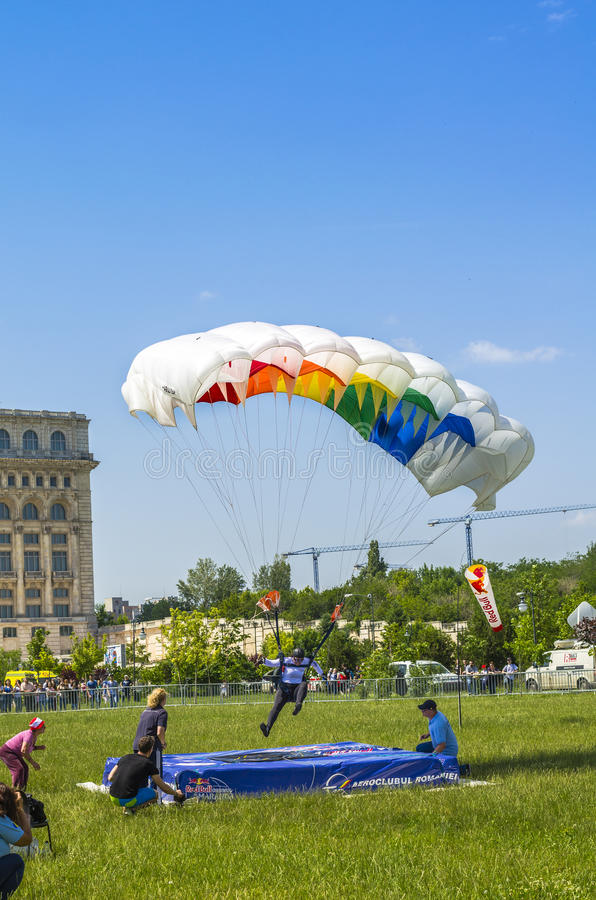 Parachutist landing royalty free stock photos