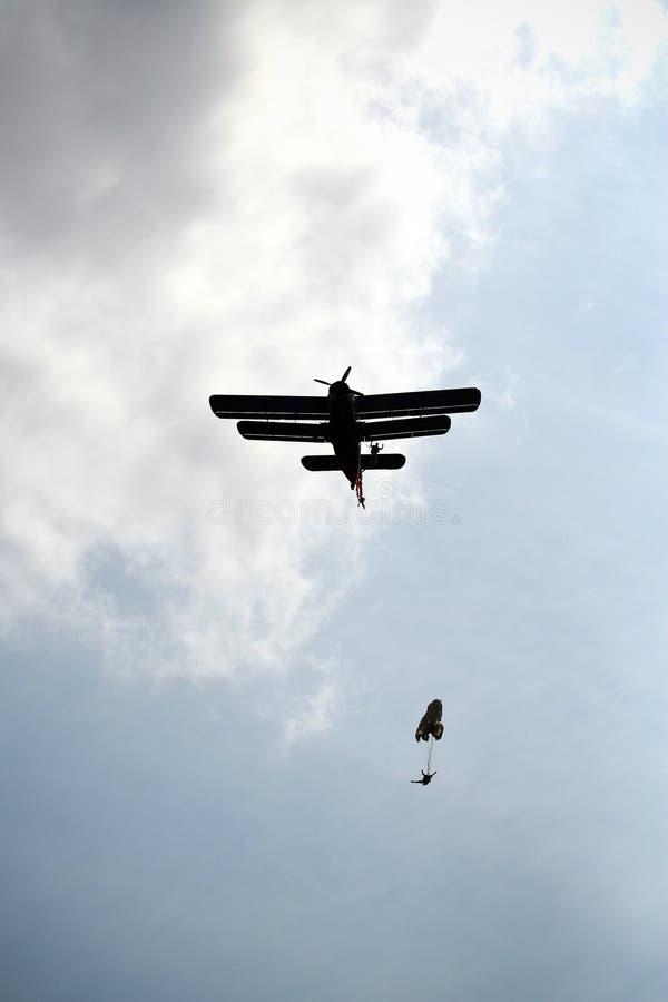 Parachutists jumping athletes stock image