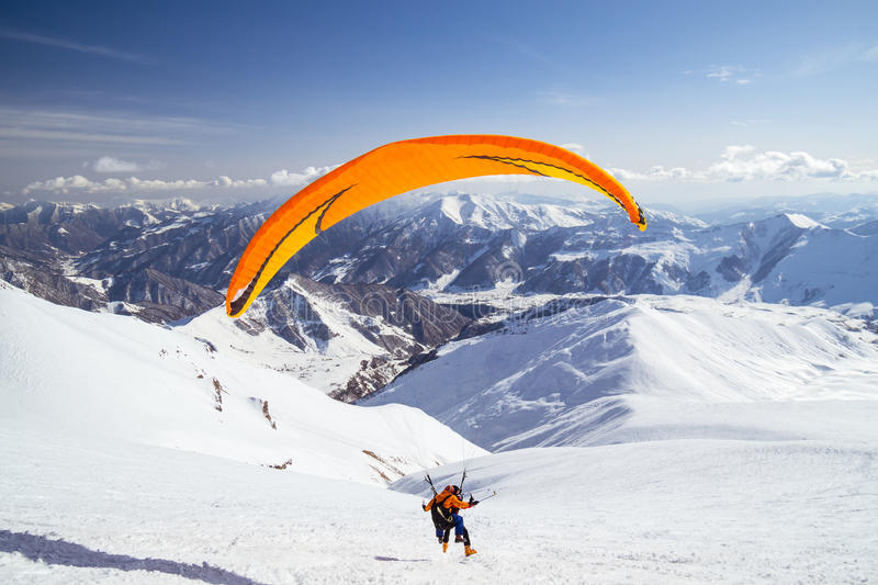 Parachute in winter. Extreme sports - parachute in winter. Caucasian mountains royalty free stock images