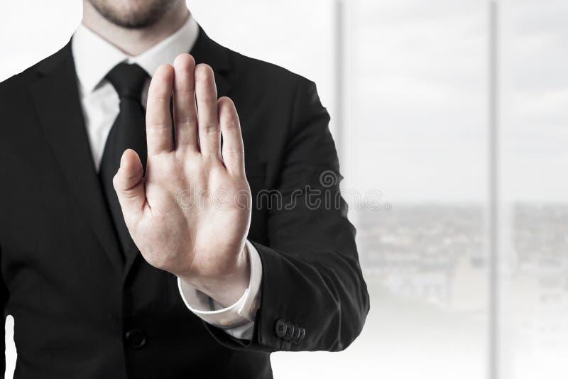 Parada da mão do homem de negócios imagens de stock